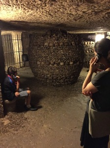 Listening to audio in Les Catacombes