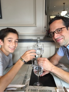 Toasting our first meal with l'eau gazeuse